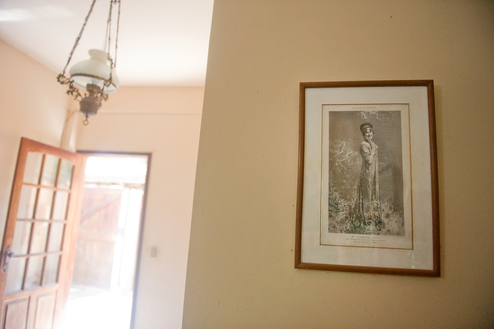 Brito's home is decorated with photos and artwork that hang on the wall. Brito, a school teacher, has maintained a middle class life in the favela.
