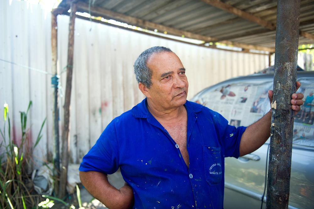 Painter Izaias Rosa lives in the town next to the area that Vila Autodromo has been proposed to be relocated to. He says that at night, they leave their doors open, but wouldn't be able to do that if the town moves next to his.