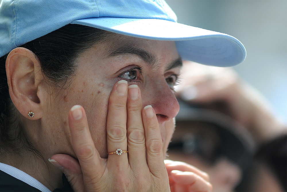 Consuelo Delgado of Browns Mills, New Jersey, wipes a tear while watching Pope Francis' mass at Cathedral Basilica of Saints Peter and Paul from jumbotrons on the Ben Franklin Parkway on September 26, 2015.