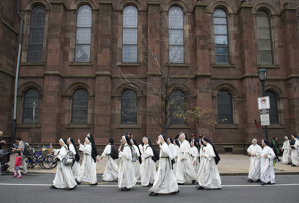 Nuns walk by Church of the Holy Trinity on Walnut Street before Pope Francis held Mass on the Ben Franklin Parkway on September 27, 2015.