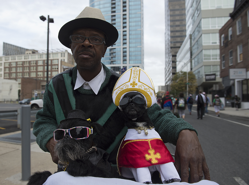 Philadelphia native Anthony Smith shows off his dogs Noodles and Diva on 21st street before Pope Francis held Mass on the Ben Franklin Parkway on September 27, 2015.