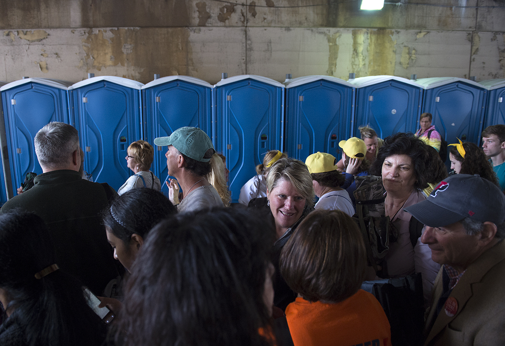 Porta Pottys line the sidewalk at the beginning of the route on 21st street as people wait to see Pope Francis' Mass on the Ben Franklin Parkway on September 27, 2015. Lines were multiple hours-long waits with no bathrooms or handicap entrances along the route.