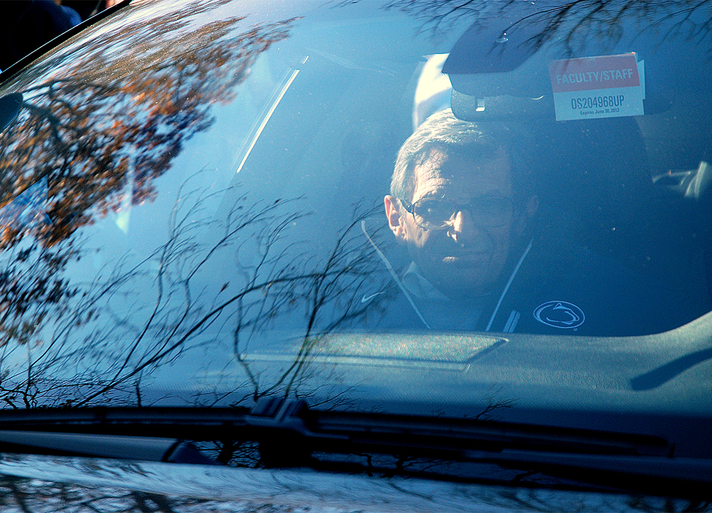 Penn State head coach Joe Paterno leaves his State College home with Guido D'Elia in his BMW on Tuesday afternoon. Media was staked outside of his home waiting for him to leave for football practice.