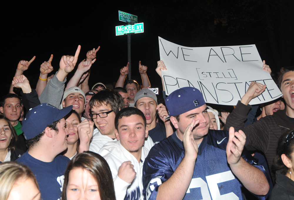 Students gather outside of head coach Joe Paterno's home in State College on Tuesday, Nov. 11, 2011 to await his arrival home from football practice. A group of about 300 students gathered outside the home in support of Joe Paterno.