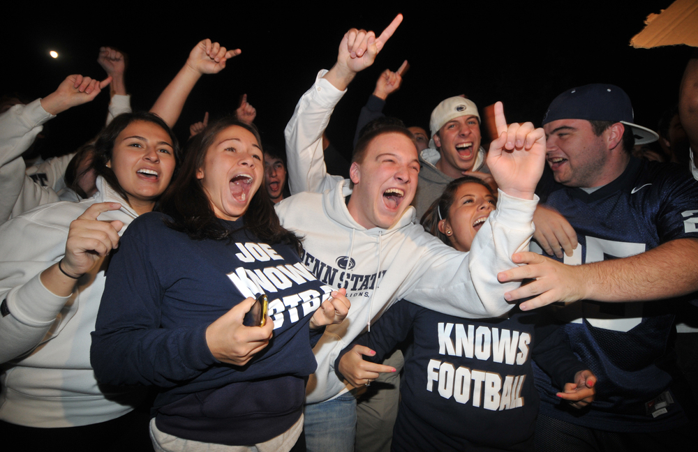"Students show their support for head coach Joe Paterno and their Penn State pride outside of Paterno's home in State College on Tuesday night. A crowd of around 300 chanted things such as ""f*** the media,"" ""beat Nebraska,"" and ""Joe-pa-terno."""
