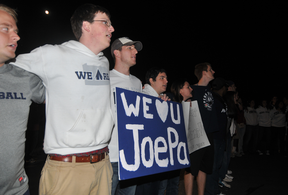 Students sing the Alma Mater outside of Joe Paterno's house on Tuesday night. About 300 students gathered in support of Paterno.