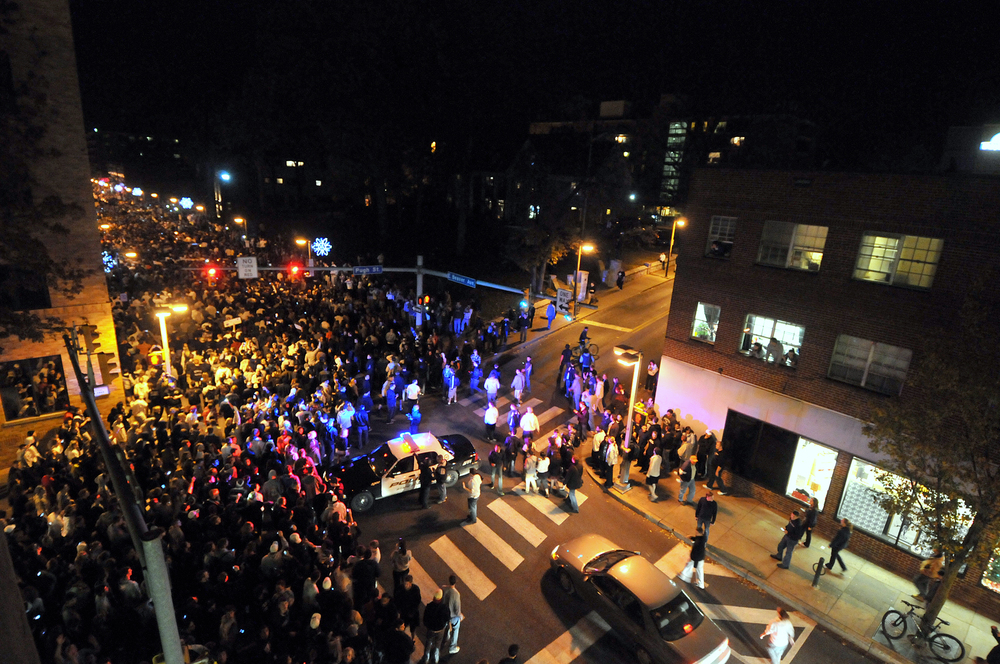 Students flooded onto Beaver Avenue on Wednesday, Nov. 9, 2011 from Old Main to protest the firing of Joe Paterno. This intersection, at Beaver and Pugh, was blocked off by police vehicles. Riot police were on standby during the press conference in which the announcement was made.