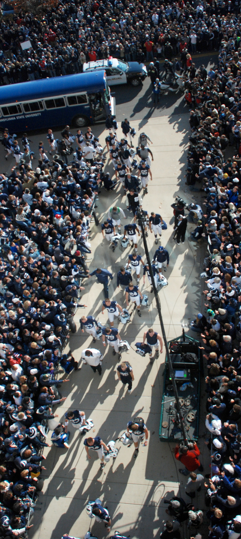 Football players step off their buses to and greet fans as they enter the stadium before their game against Nebraska on Saturday, Nov. 12, 2011.