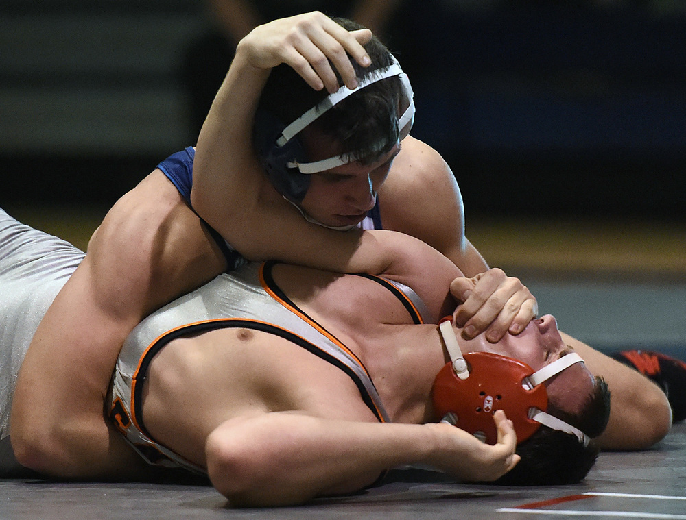 Council Rock North's Josh Shalinksy wins his 100th career match against Pennsbury's Connor Gowton in their 170-lb bout during their match at Council Rock North on Wednesday, Dec. 23, 2015.