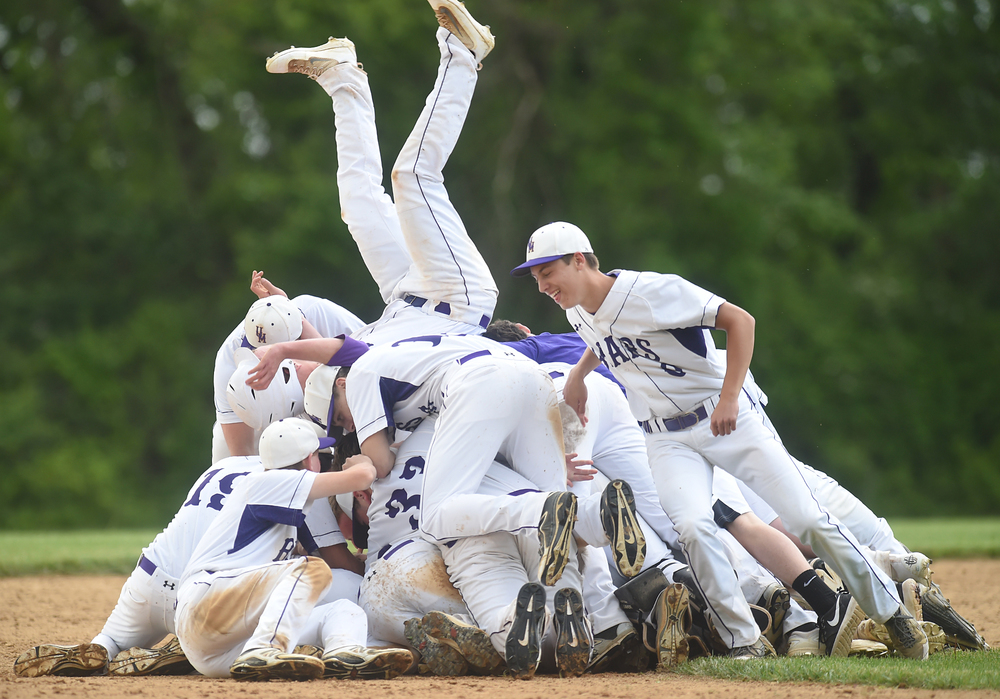 Upper Moreland players jump on top of teammate Randy Meehl (11) to celebrate after he hit a single to get a runner home in the bottom of the seventh during their game against Phoenixville in Upper Moreland on Tuesday, May 24, 2016. Upper Moreland won the game 1-0.