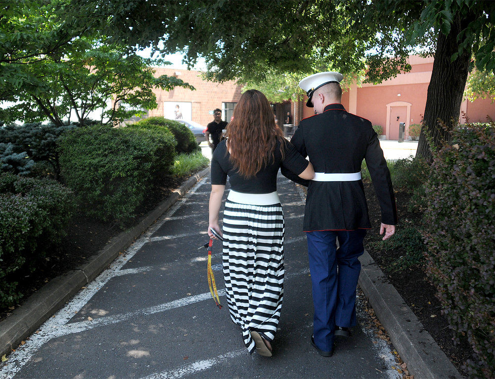 Dee Hubay walks with her then fiancé and now husband Dan Bryan into the Oxford Valley Mall in Middletown Township on Monday, July 20, 2015 to search for wedding rings.  Bryan was in the area on a break from his MOS school for his job training, which was in Cory Station Pensacola, FL, and Goodfellow Air Force Base in San Angelo, TX. The two got engaged in hopes of being stationed together for their Marine Corps careers.