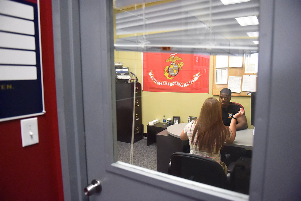Dee Hubay participates in a final interview before leaving for boot camp at the US Marine Corps Recruiting station on Cottman Avenue in Philadelphia on Sunday, August 23, 2015.