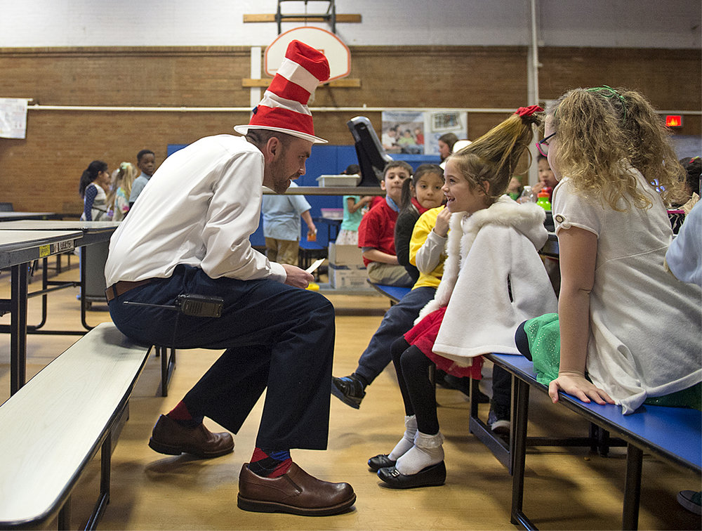 School Lane Charter School Vice Principal Jim Munizza, dressed as The Cat in the Hat, talks to first grader Kiersten, 6, in costume as Cindy Lou Who, before reading Oh, the Places You'll Go! to her class while celebrating Dr. Seuss' birthday at School Lane Charter School in Bensalem on Thursday, March 2, 2017.