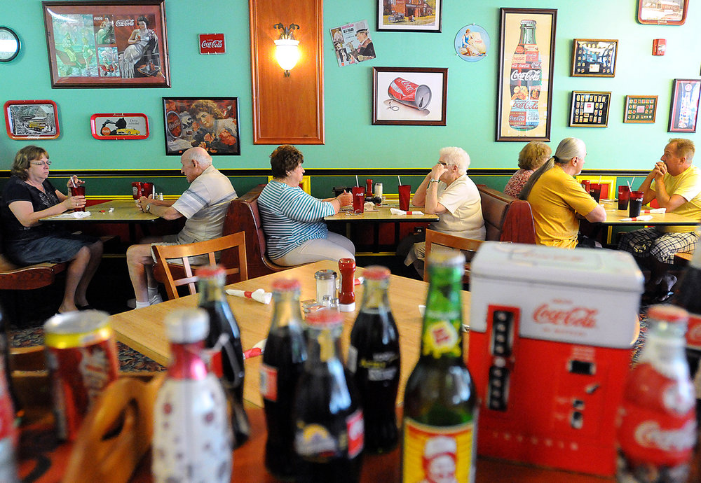 Customers eat at the Coca-Cola-themed Maryanne's Homestyle Cooking, which has reopened in Middletown Township after a fire last year at its location in Croydon. The restaurant has been in business for 27 years.