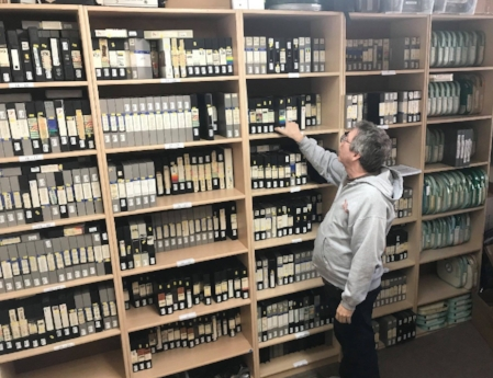 Reelin' in the Years President David Peck inspects the newly arrived Brian Linehan collection.