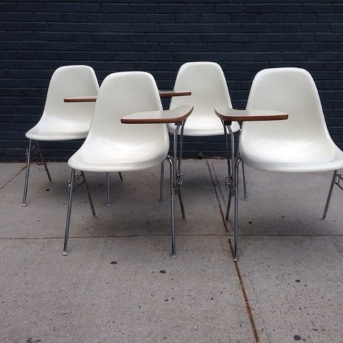 set of four eames dss fiberglass stacking chairs with tablets