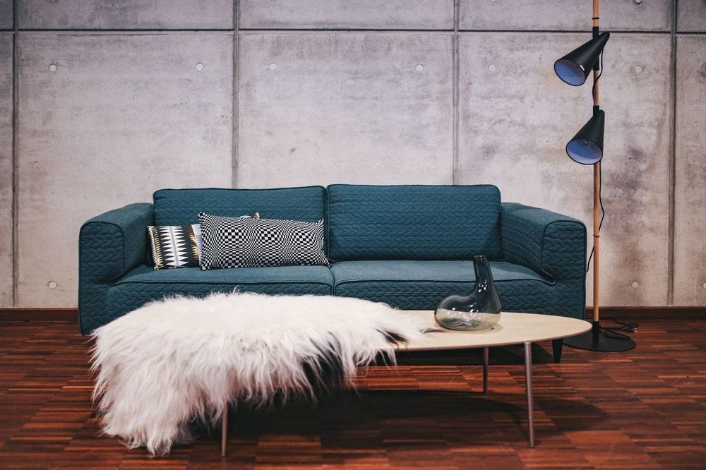 kaboompics_Blue-sofa-with-pillows-in-a-designer-living-room-interior-compressor.jpg