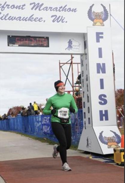 Crossing my first marathon finish line in 2012, Milwaukee Lakefront Marathon