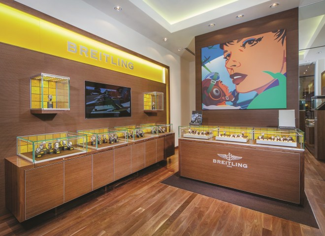 From dark, more formal interiors, Breitling's new store at Greenbelt 5 is brighter, more inviting and retains those trademark splashes of yellow. It also features a reproduction of a pop art painting of American artist  Kevin T. Kelly .