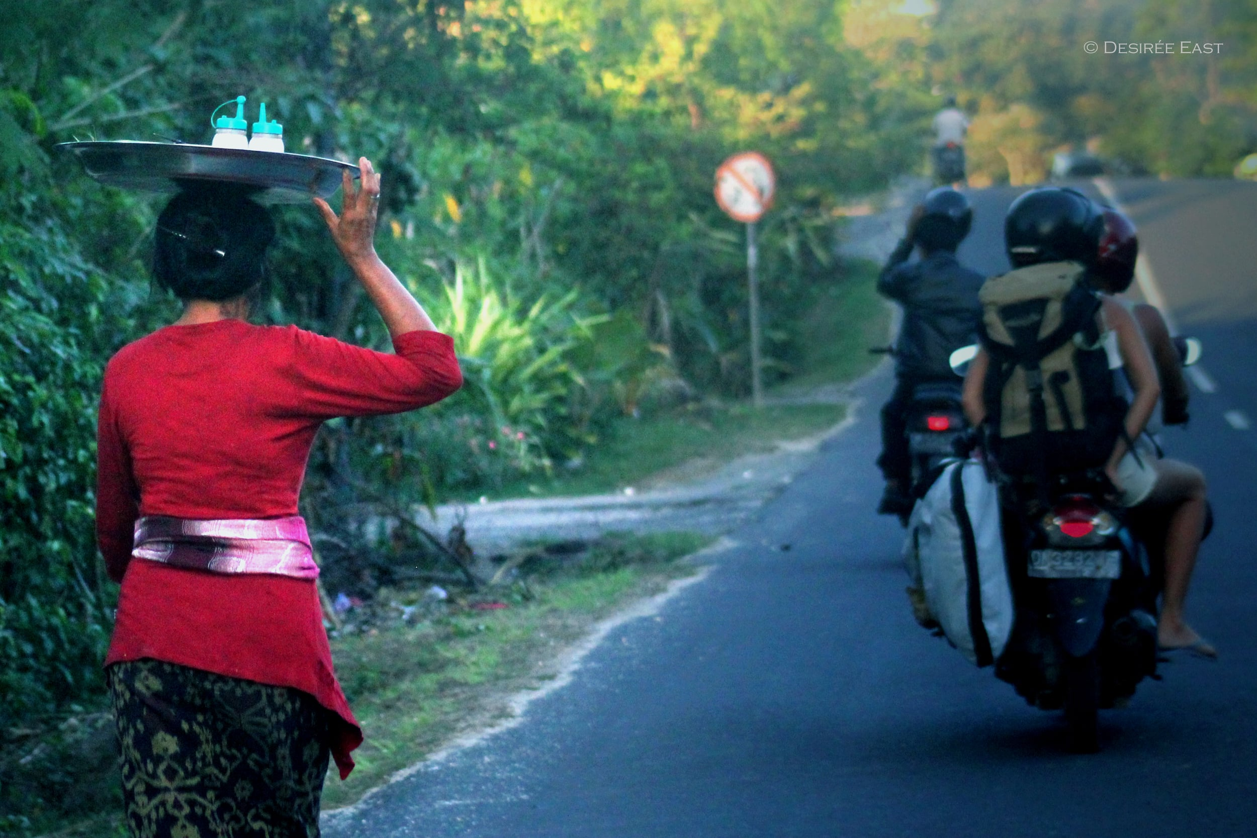 balinese woman in red. bali, indonesia. photo by desiree east