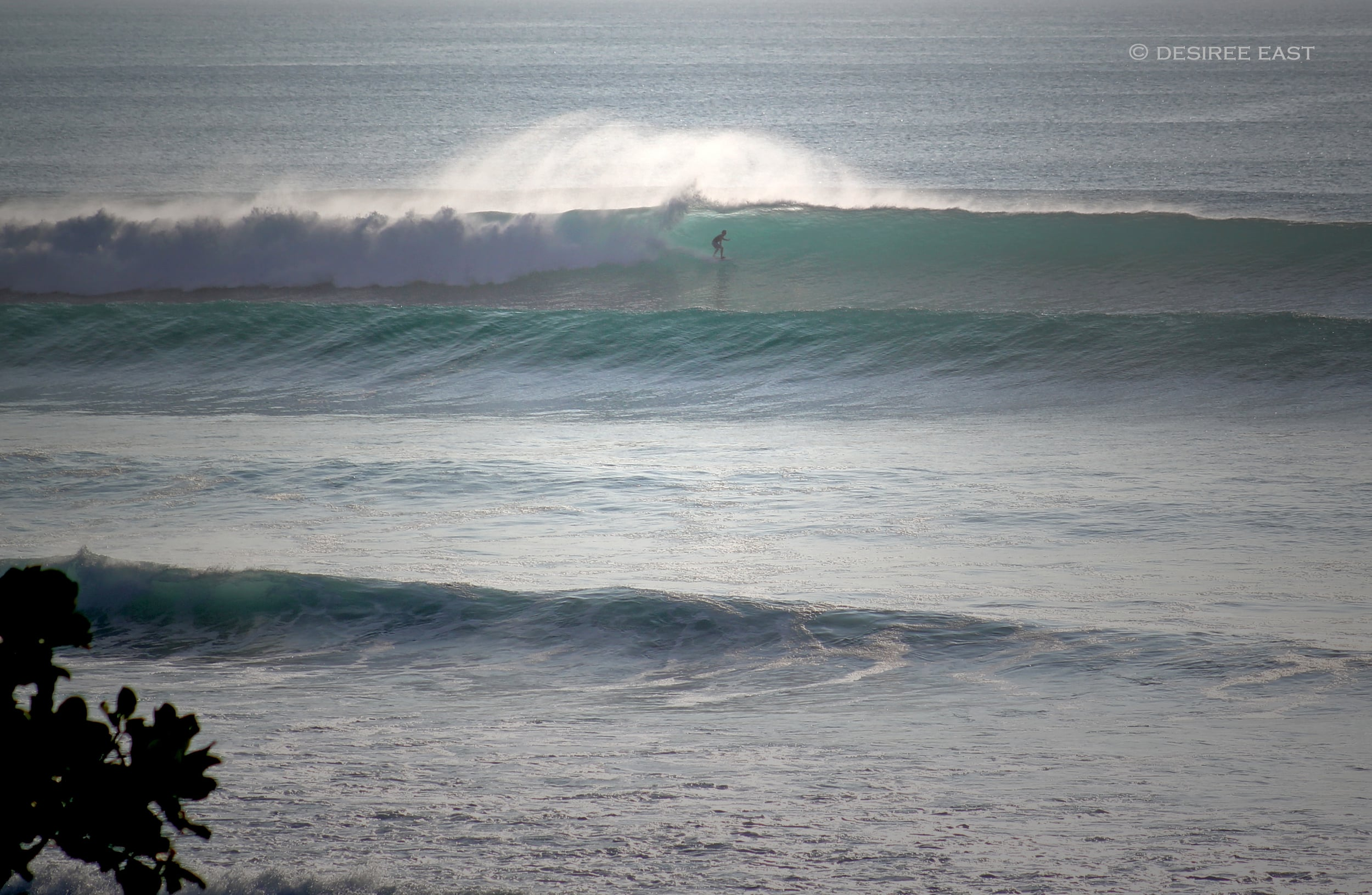 lonely guy getting barrelled. bali, indonesia. photo by desiree east