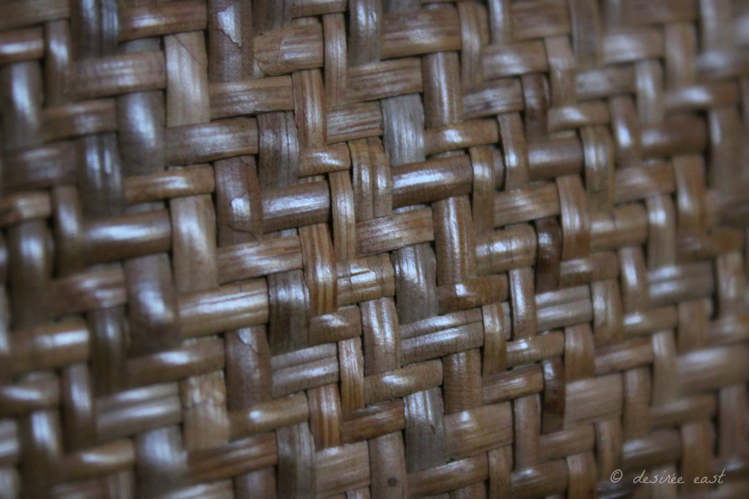 Woven, handmade artwork from the island of Borneo. Straight lines repeat themselves. Photo by Desiree East