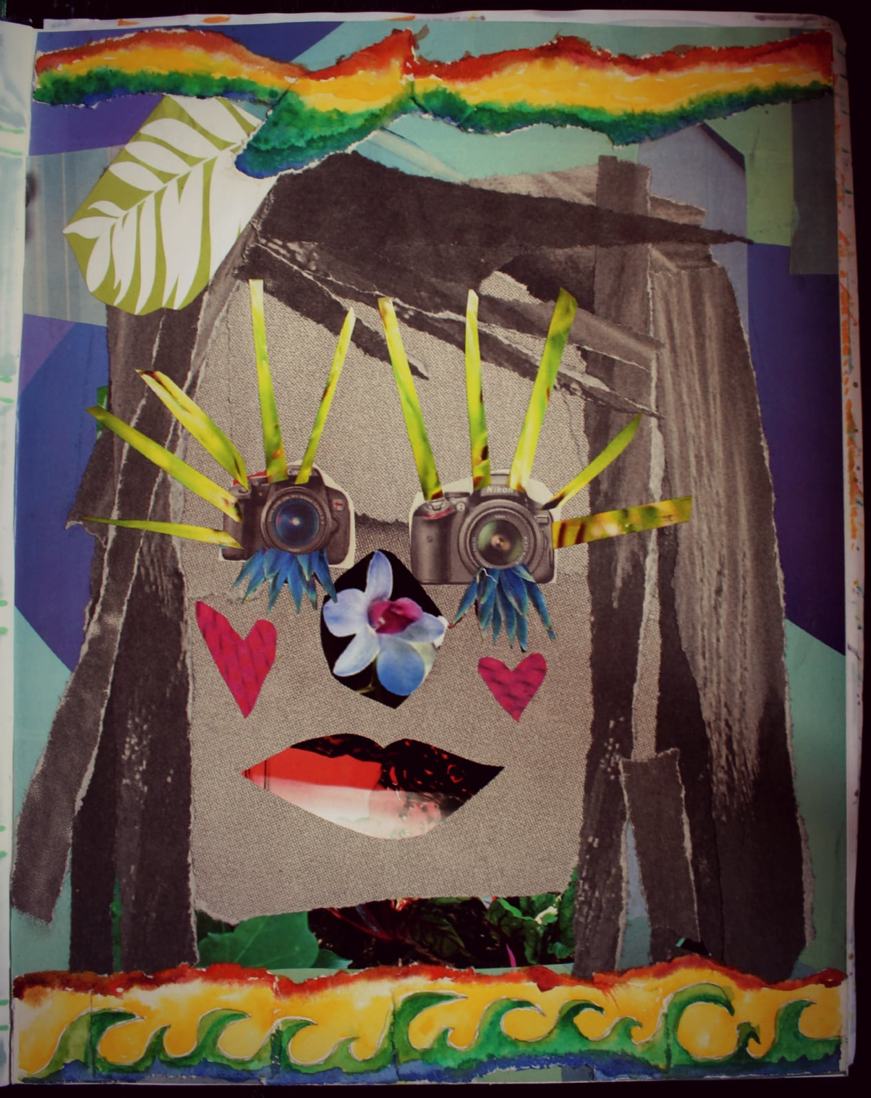 torn paper face collage, a creatively fit exercise. by desiree east