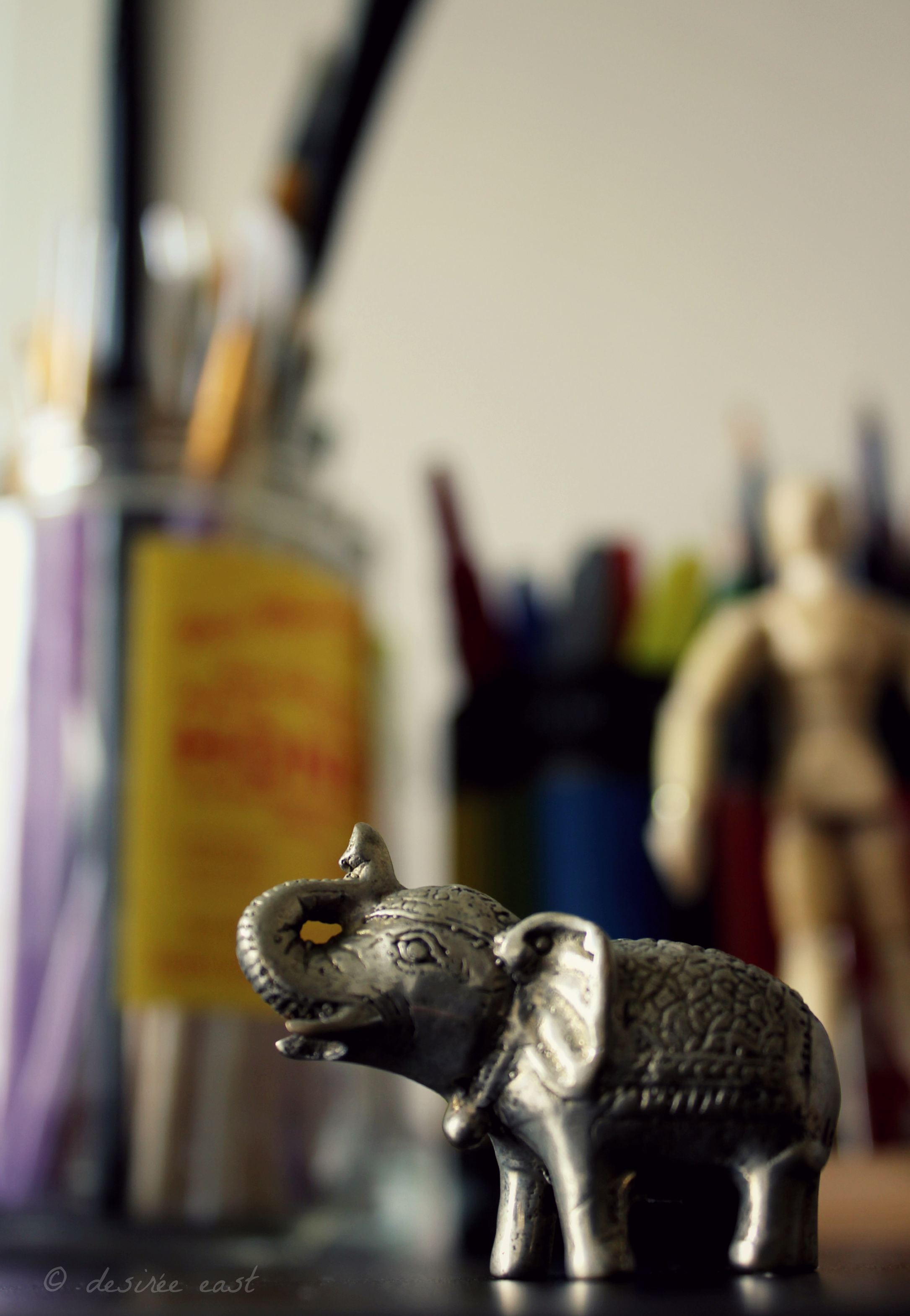 a gift from bali and my tiny, little studio mascot. photo by desiree east