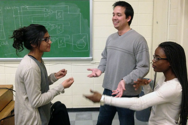 Steve Engels pictured with University of Toronto students. Image source: utoronto.ca