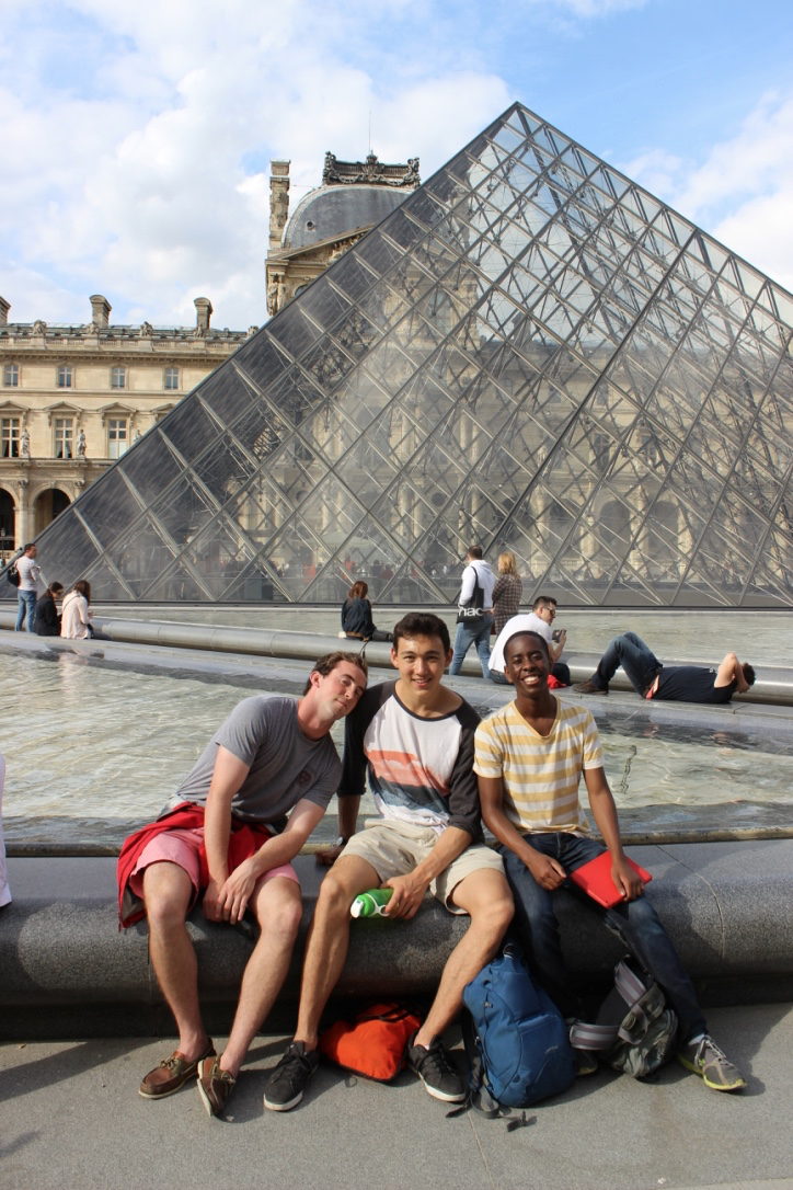 By one of the Louvre's famous pyramids