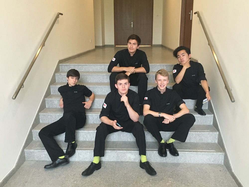 Striking our best boy-band poses in shirts generously given to us by the CEIBS Maple Choir