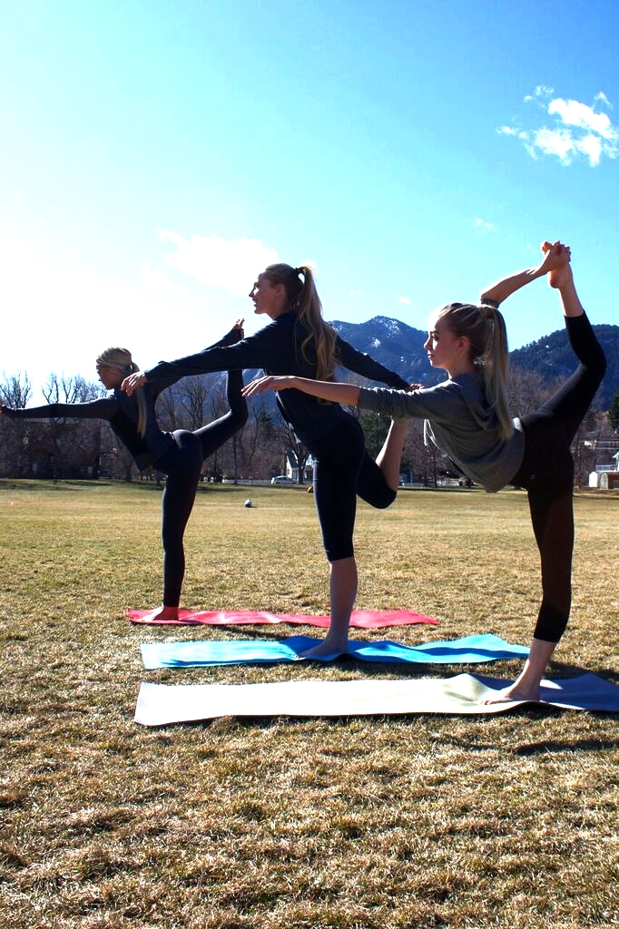 Aspen Tan clients doing yoga at North Boulder Park.