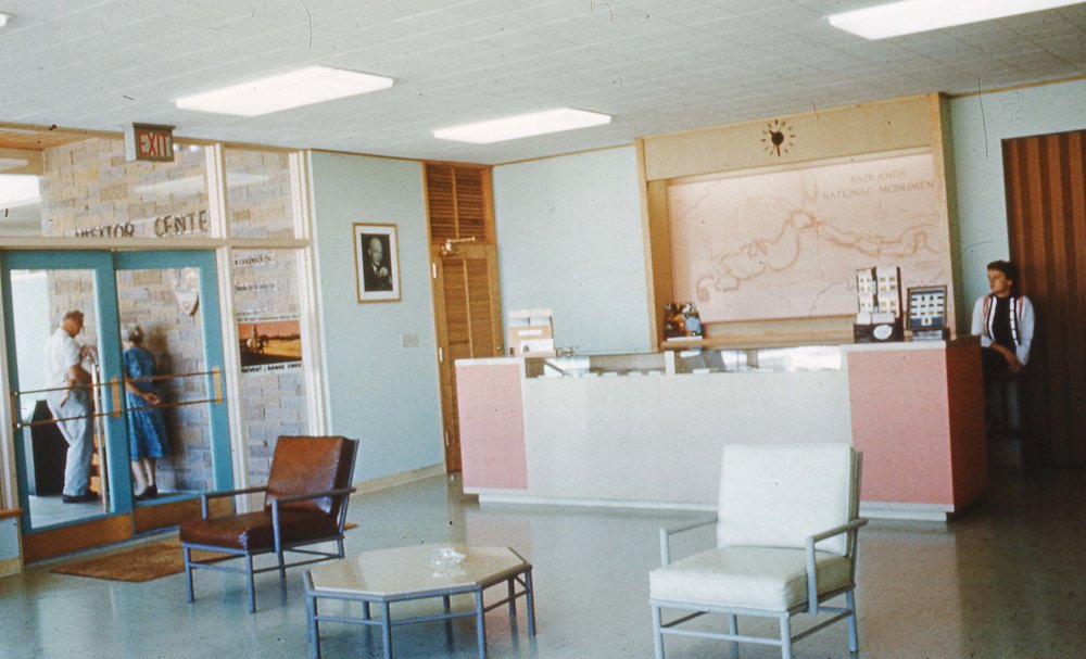 Information desk inside the visitor center, c. 1960.