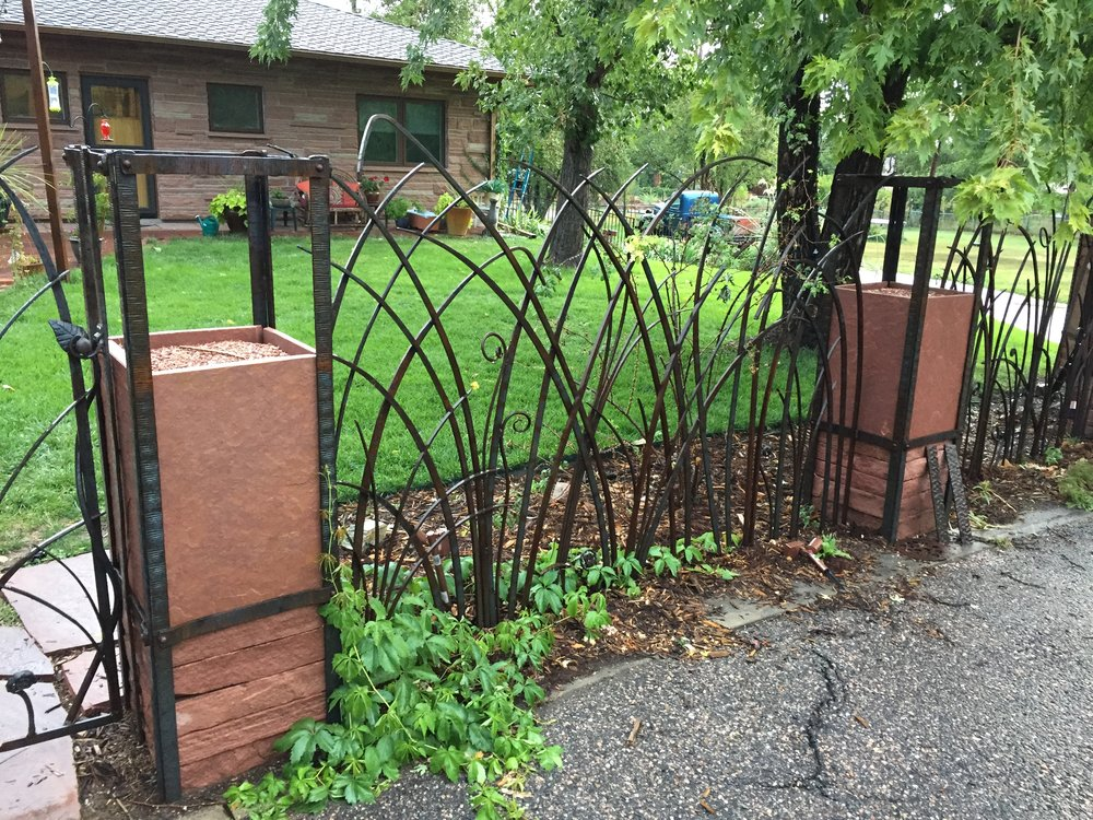 Wrought Iron and Red Flagstone Columns