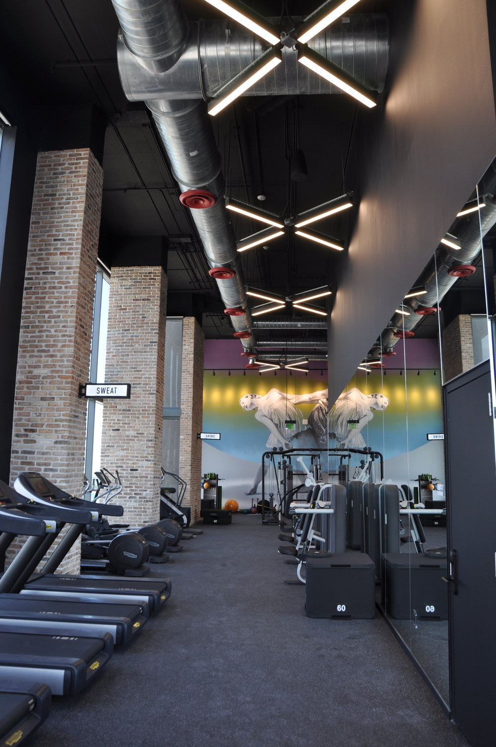 "Horton Lees Brogden Lighting Design used the VersaLux LED Pendants from Starfire in a ""X"" formation at the Vice Fitness Center  in Miami"