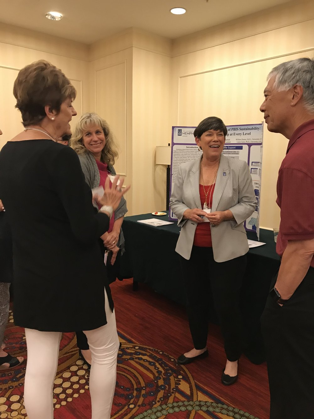 Team members Paula Brownyard and Carolyn Stark discuss our poster with George Sugai, a world renowned leader in PBIS research.