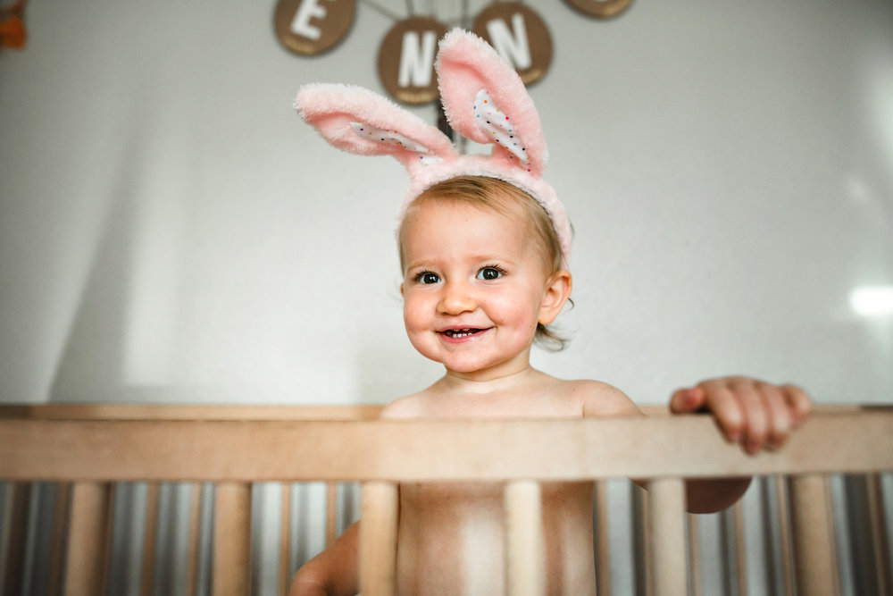 baby plays in crib wearing diaper and bunny ears 4-(ZF-0126-04493-1-011).jpg