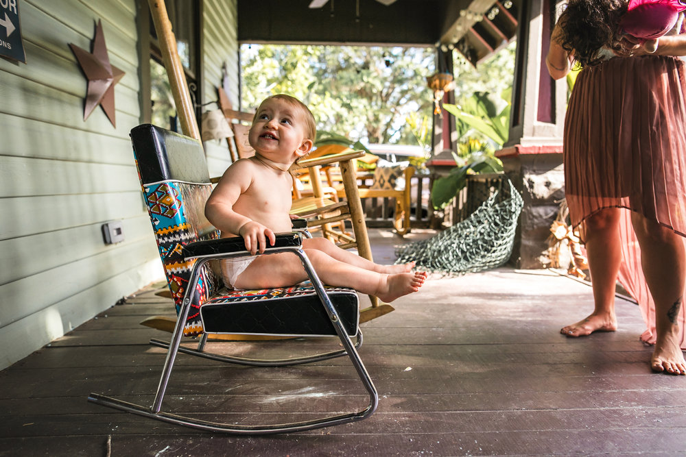 baby sits in rocking chair on front porch wearing a diaper-(ZF-0126-04493-1-031).jpg