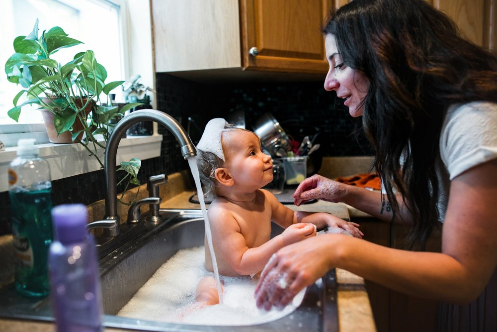 Babies bathing in sinks are simply the best! And it's the only way to get all that sticky waffle off.