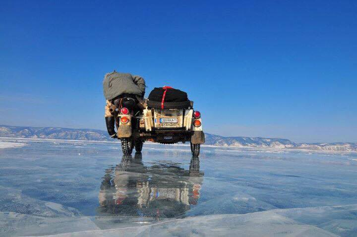 Ural side cart bike on Ice of Lake Baikal, photo by Hubert