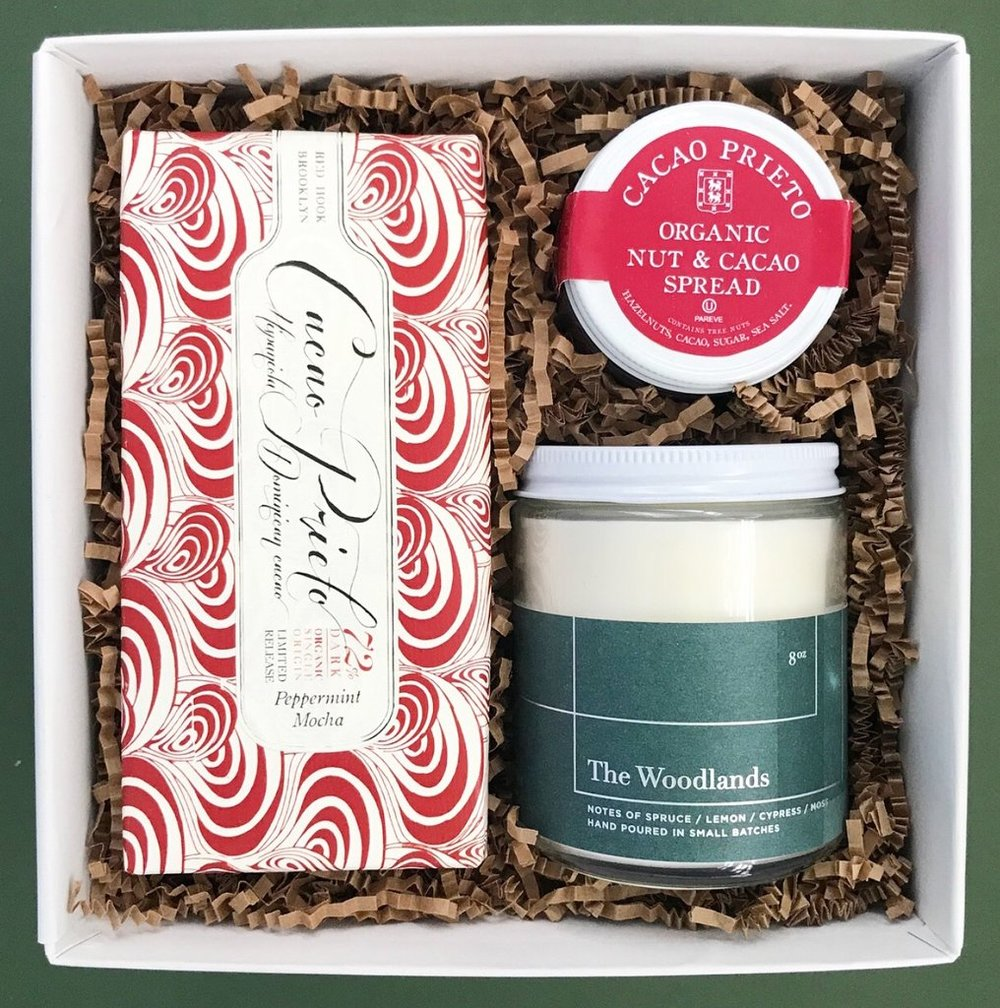 The Mistletoe gift box from Teak & Twine. Pre-made gift boxes re a little pricey but if you have a high end business or don't want to spend the time putting a gift together these are a great option. -