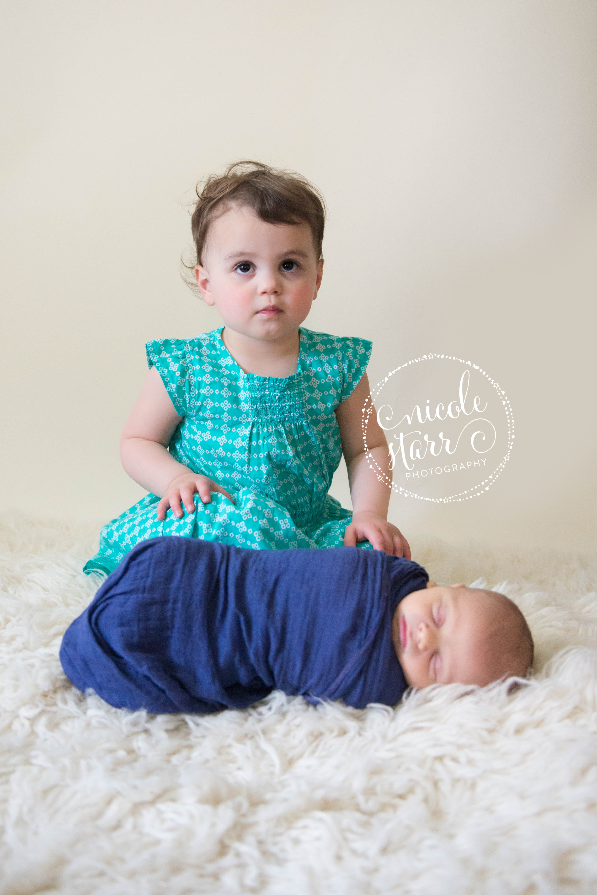 newborn with toddler sister photo
