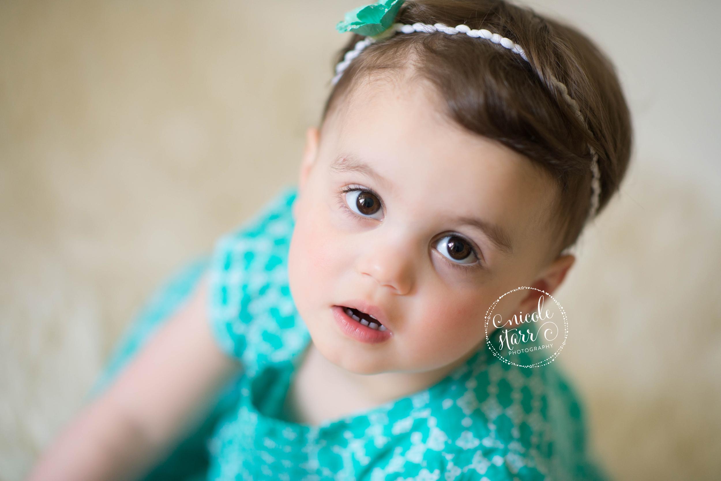 beautiful toddler girl with headband