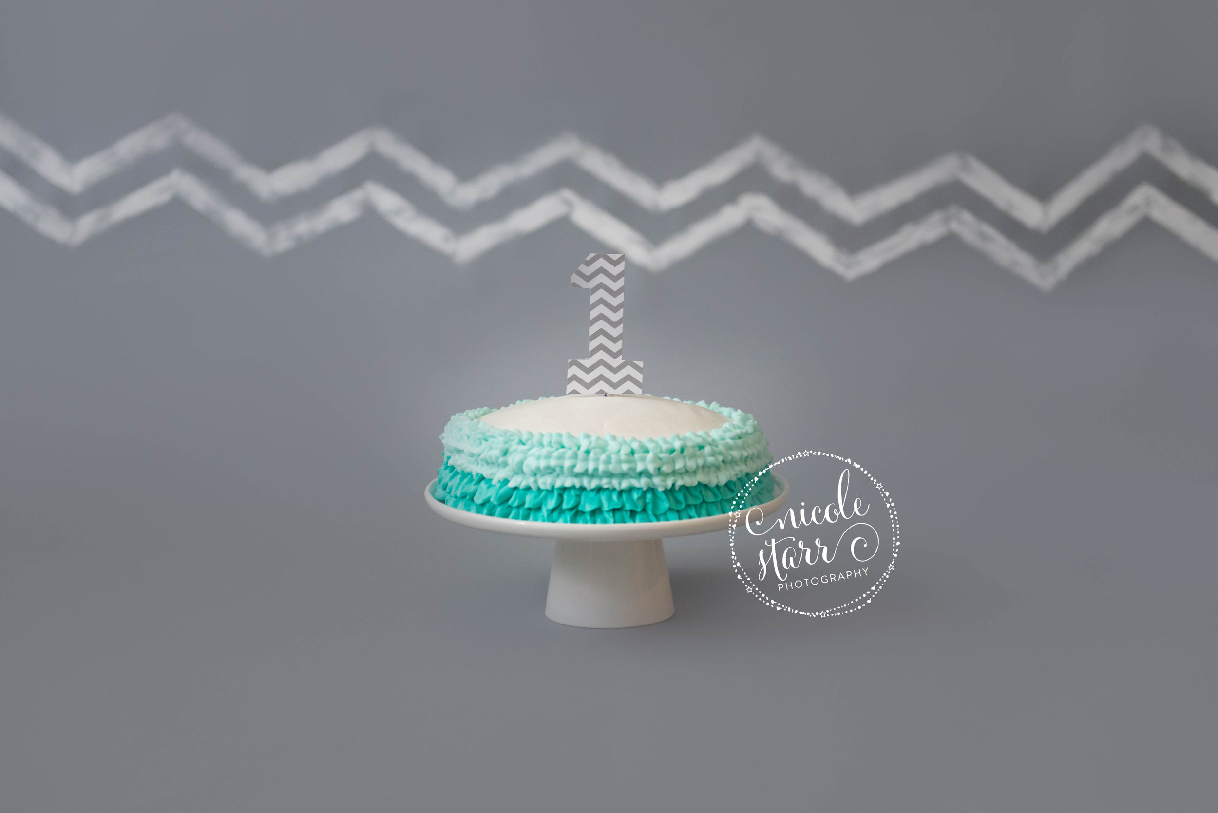 chevron and teal ruffles cake smash set up photo shoot