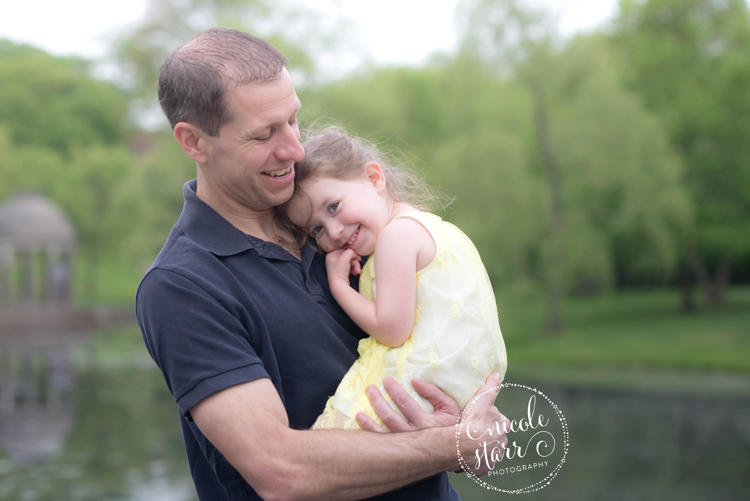 father daughter hugs at brookline park photo