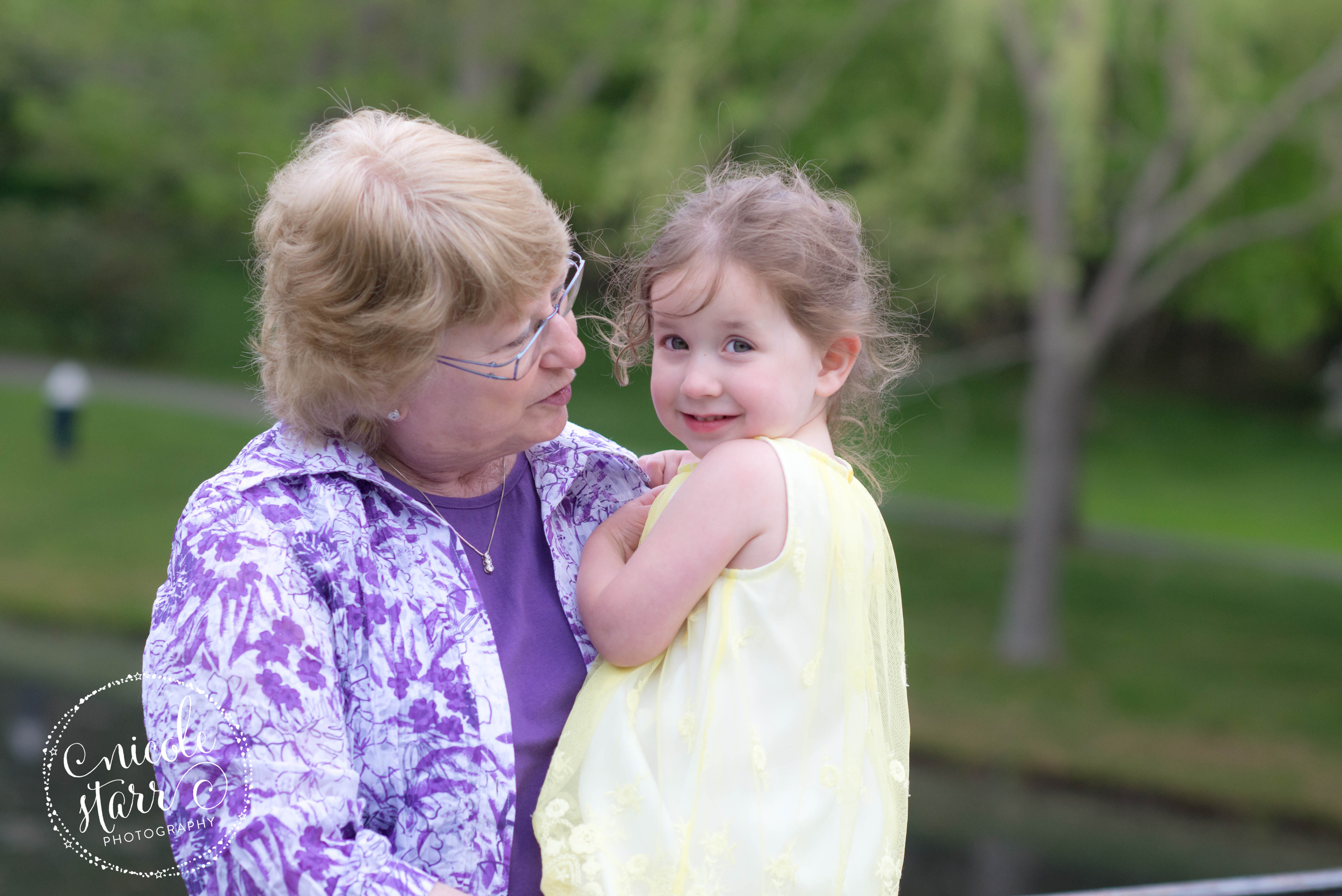 grandmother with granddaughter at a pond in brookline