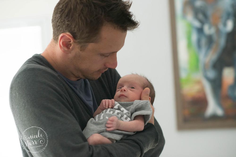 father cuddling baby boy
