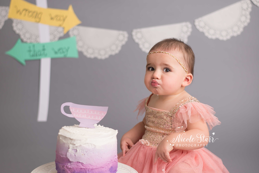 alice in wonderland baby girl cake smash with nicole starr photography