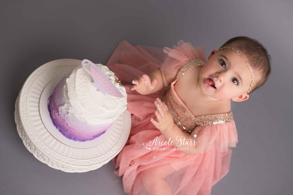 pink and purple cake smash with nicole starr photography