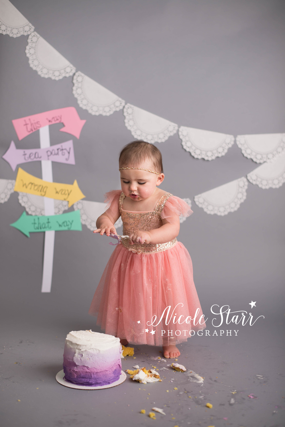 sparkly baby girl cake smash with alice in wonderland theme with nicole starr photography